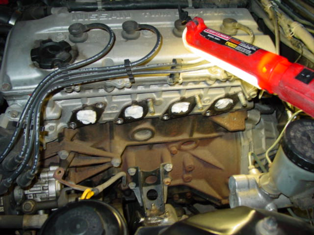 With the manifold out of the way, you will need to clean off the original gasket material. I would take a moment and stuff the ports with paper towel so that you do not get any gasket material inside the engine.