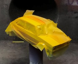 To get even coverage of yellow, I had to spray primer on some of the orange over spray (from the tape popping up around the fender flairs). After a thin coat of primer, I sprayed a few coats of yellow.
