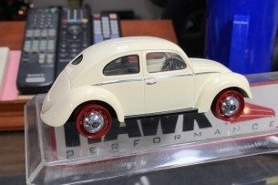 After painting the wheels for the bug, I tried them on. They are too big for the project but I believe it will look good with the right tire.