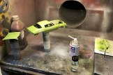 Once I finished prepping the primer on the Camaro, I started dusting the Testors lime green paint.