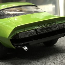 I liked the idea of having the tips bent down and peeking out from behind the bumper.