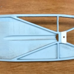 To remedy the molded in single exhaust, I cut out the floor where I could and ground out the rest.