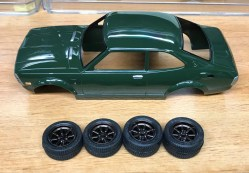 """Once the wheels arrived, I painted them Tamiya bronze, sealed them with Tamiya smoke then painted the lugs and center caps. I found a pair of """"disks"""" in my parts box that I used to simulate drum brakes for the rear."""