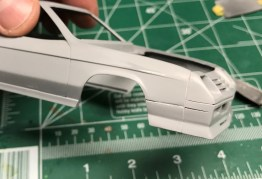 Even in completely un-modified form, the body kit on the charger looks clunky. After contemplating where I wanted character lines, I elected to extend the line from the finder ground effects forward through the bumper. I used a razor saw to make the cut.