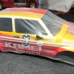 I almost forgot to spray the side molding! I used Tamiya's flexible masking tape to set the edge and wrapped it in parafim.