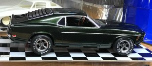 When I glued the chassis to the body, the Mustang developed a slant towards the front. I didn't like this and fixed it by cutting the rear springs and adding spacers.