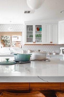 Kitchen with marble countertop, backsplash