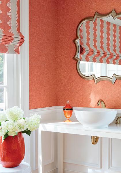 Orange bathroom walls with white trim and a Flat Roman shade