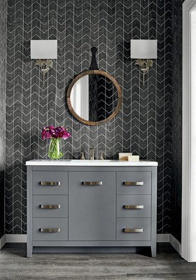 Black and white chevron wallpaper by Thibaut- contemporary style vanity with brushed nickel accents- metal leaf sconces- round barn wood mirror in a dark finish- Impressive Windows & Interiors - Hastings, MN