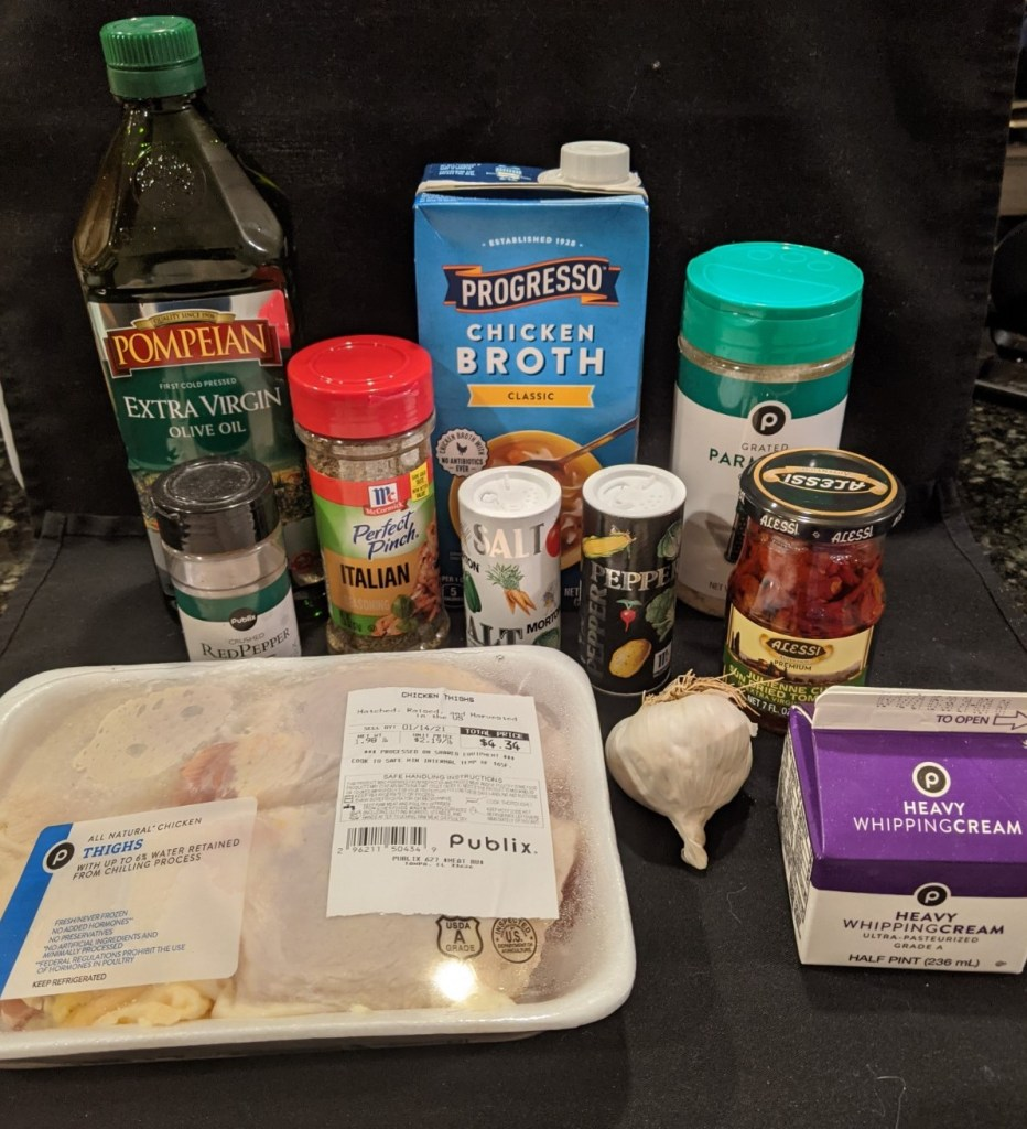 Ingredients include chicken thighs, heavy cream, sundried tomatoes, grated parmesan cheese, fresh garlic and spices