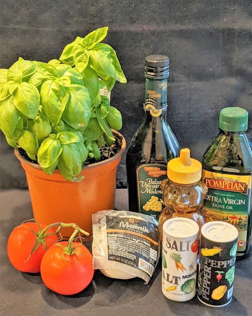 Ingredients include fresh basil, ripe tomatoes, fresh mozzarella, balsamic vinegar, honey, olive oil, salt & pepper