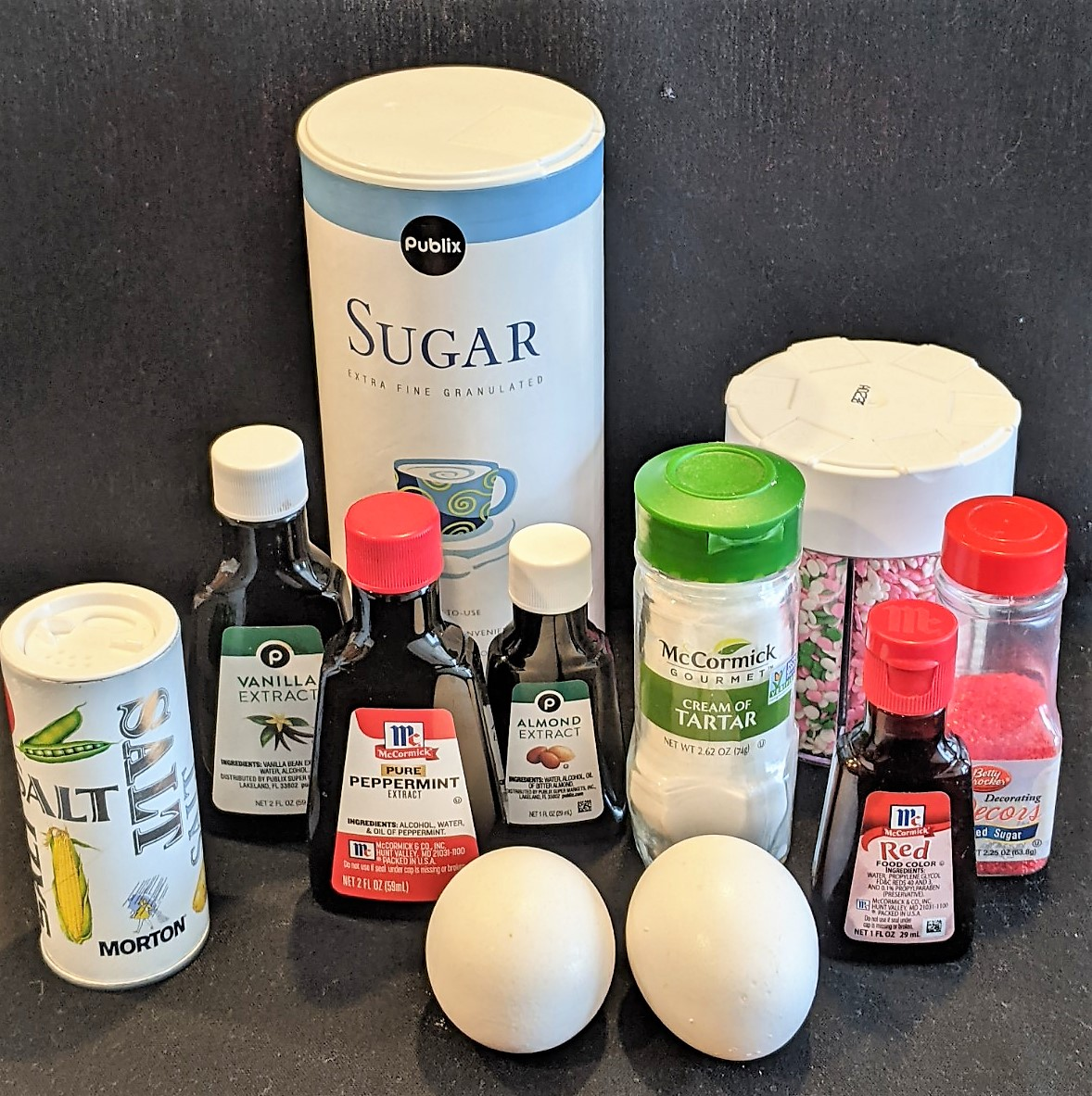 Ingredients are 2 egg whites, sugar, cream of tartar, salt and your choice of flavor extract (vanilla, almond or peppermint).  Optional red food coloring and decorations.
