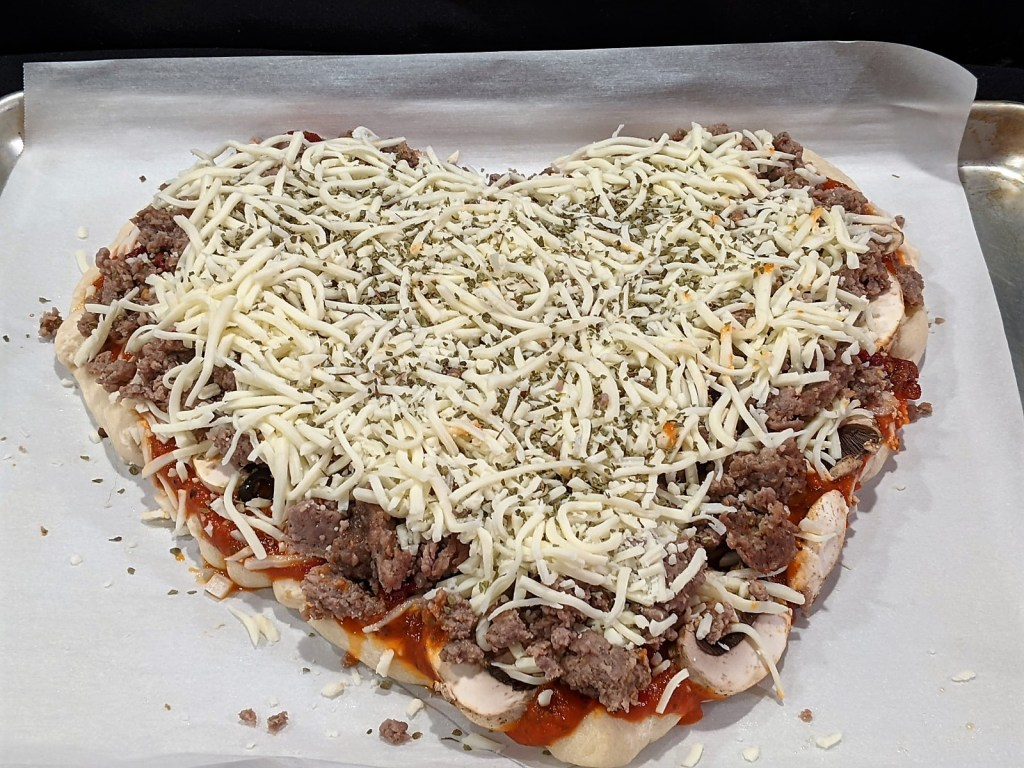 Shredded cheese and seasonings added to heart