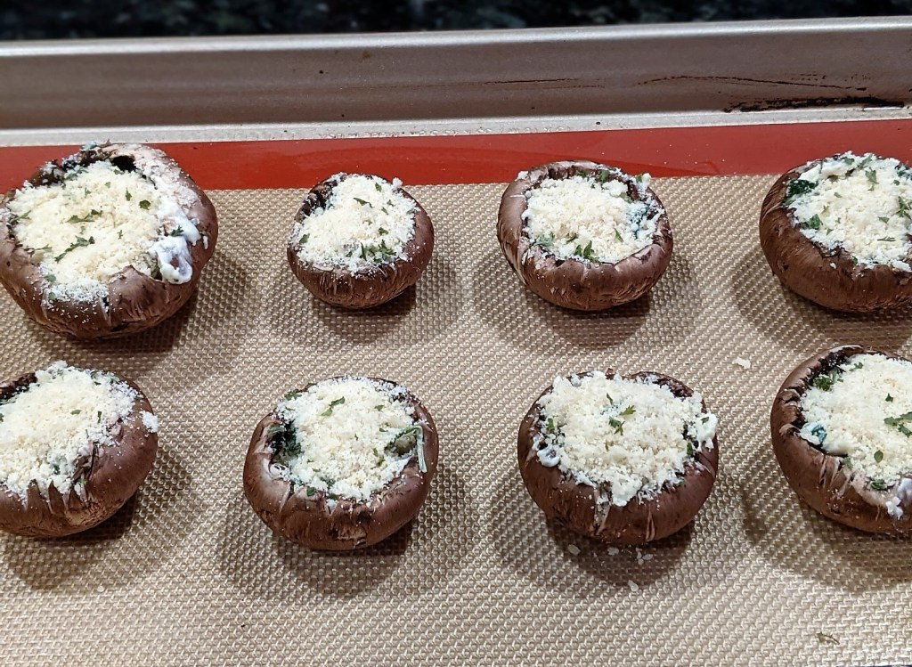 sprinkle mixture of bread crumbs and parmesan cheese on top of the stuffed mushrooms.