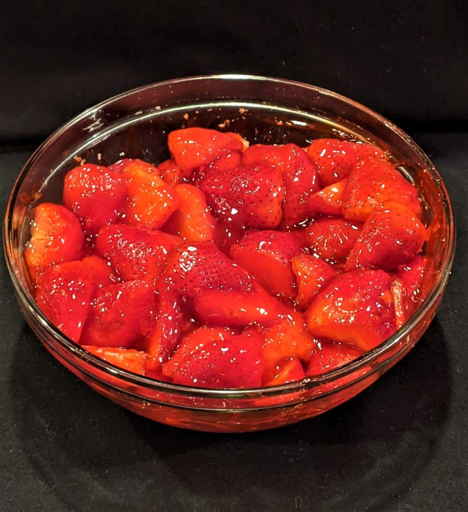 Bowl with strawberries and glaze