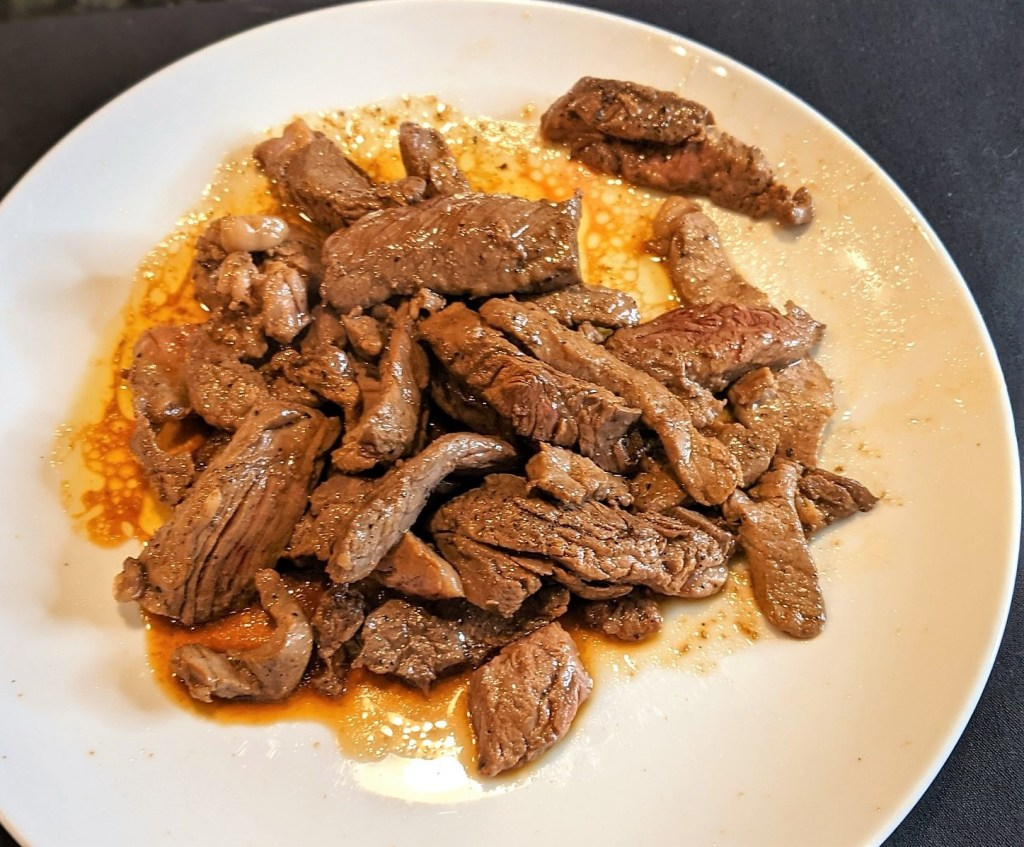 Plate with cooked beef strips