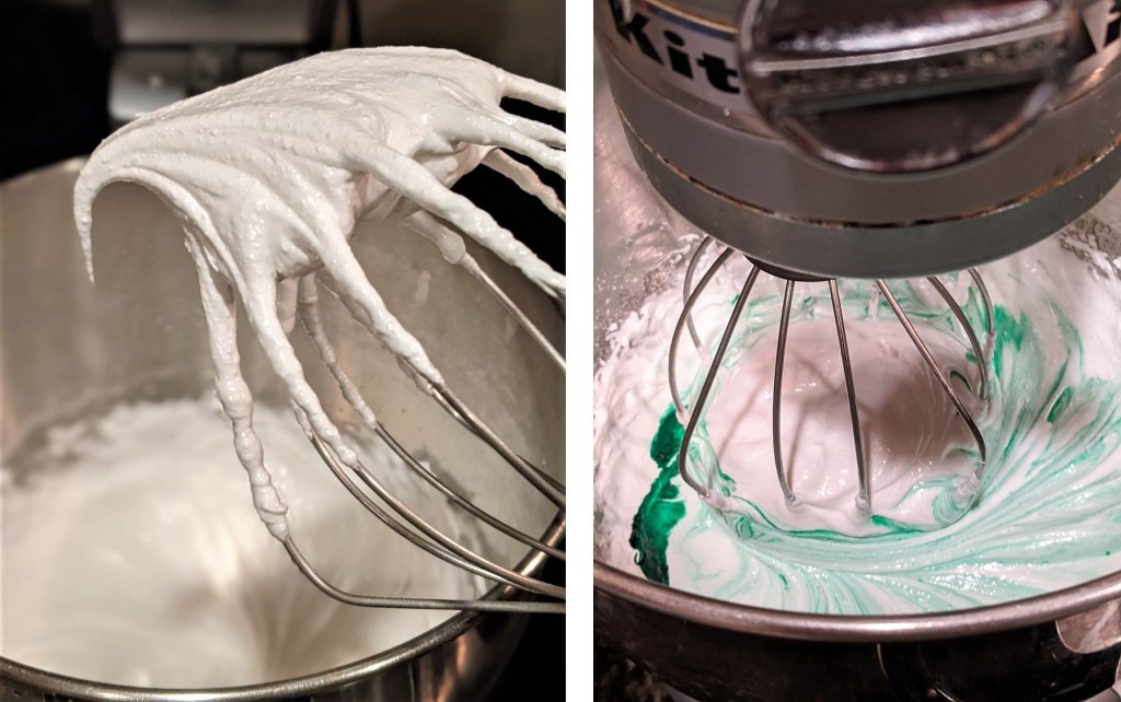 Mixing bowl with stiff egg whites and mixing bowl with green food coloring
