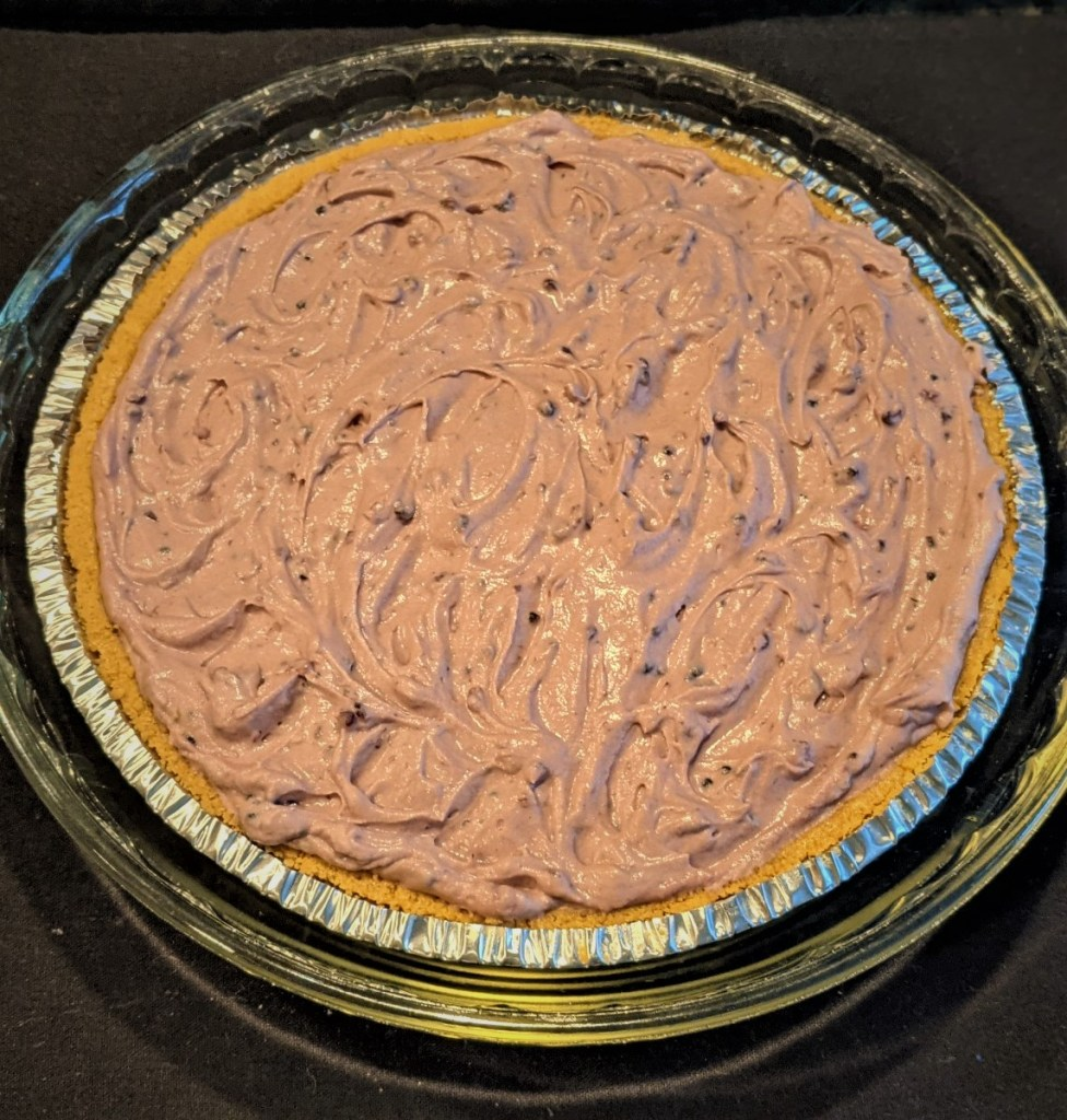 Filling in crust and placed in a glass pie pan.