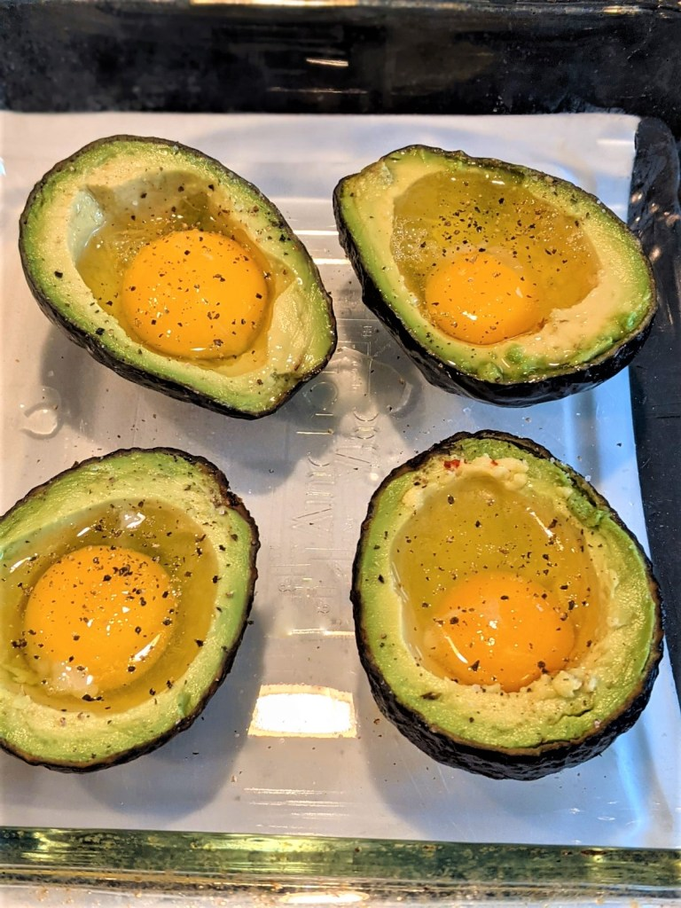eggs and avocados in baking dish