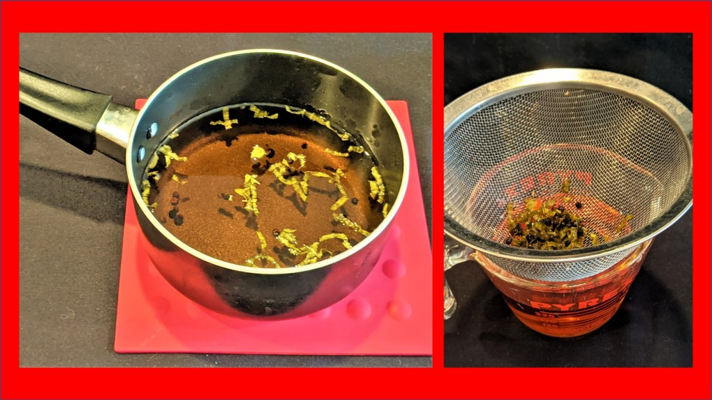 Saucepan cooling and strainer with basil and peppercorns on top and vinegar below.