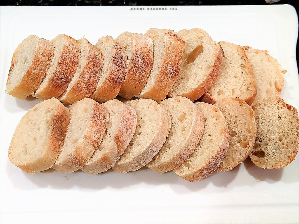 sliced baguette on a cutting board