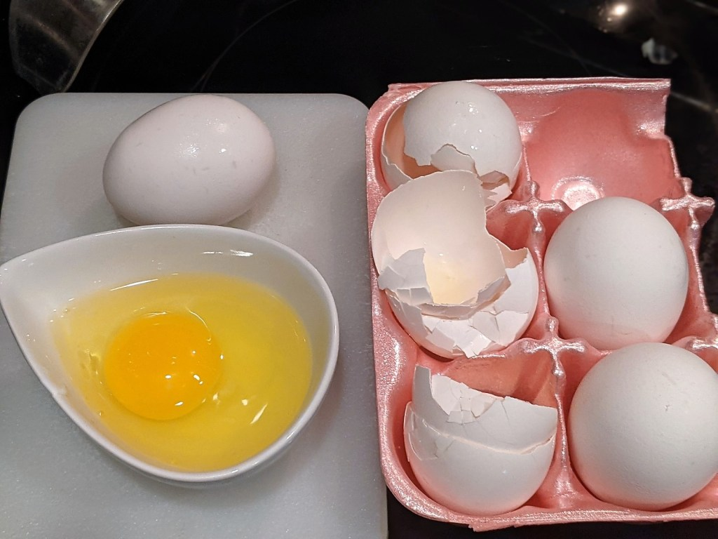 images of eggs, whole, egg shells and crack in a bowl.