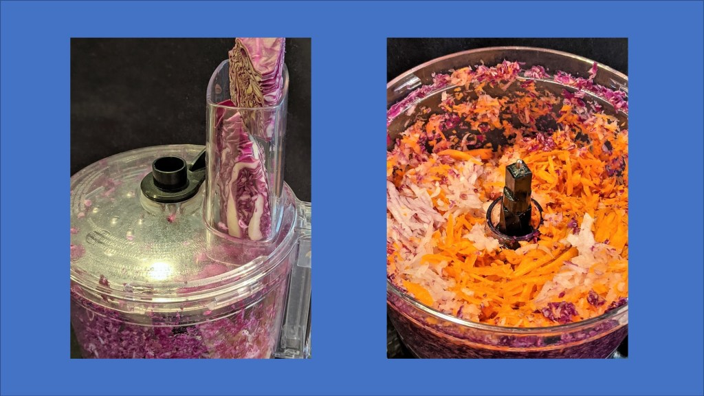 Food processor with cabbage.  Food processor with shredded carrot, onion and cabbage