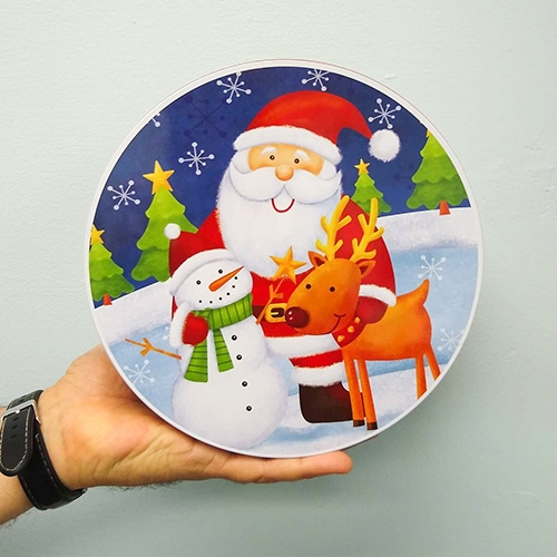 Round holiday tin with Santa