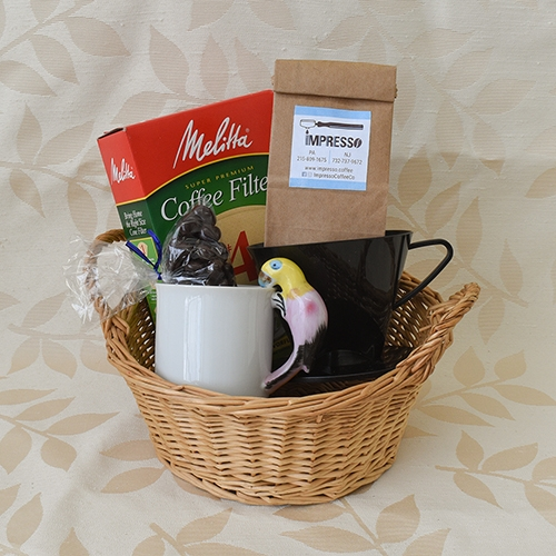 Gift basket with coffee bean, coffee filter, cone dripper, mug and chocolates