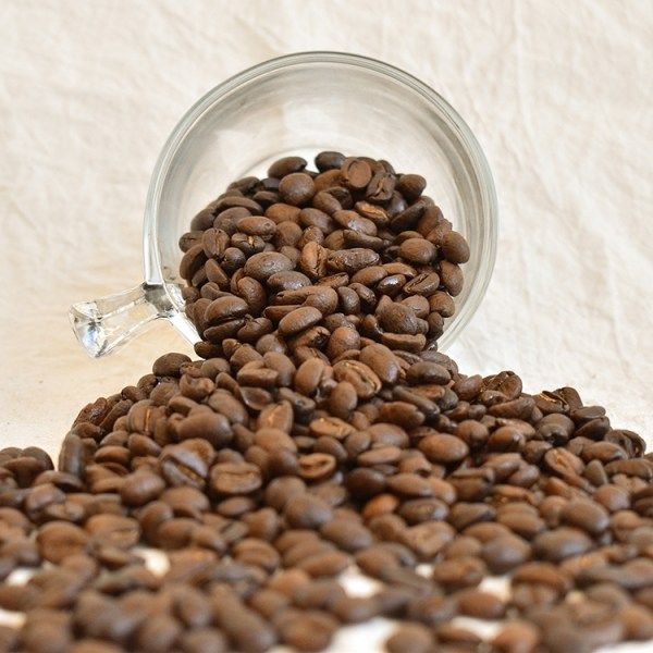 Colombian bean spilling out from a glass