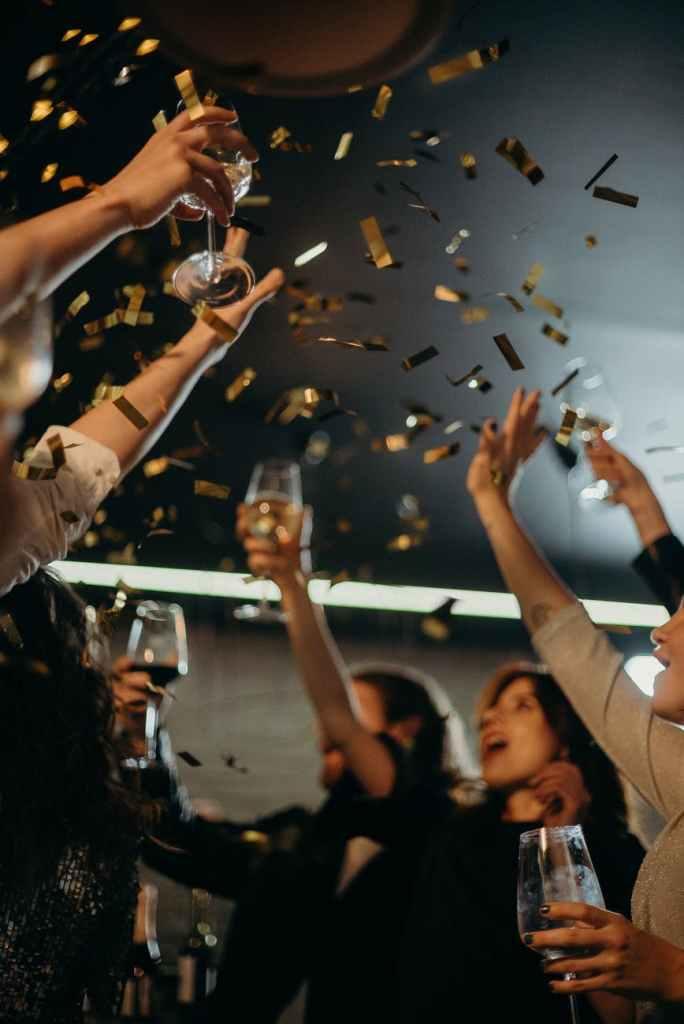 people enjoying confettis