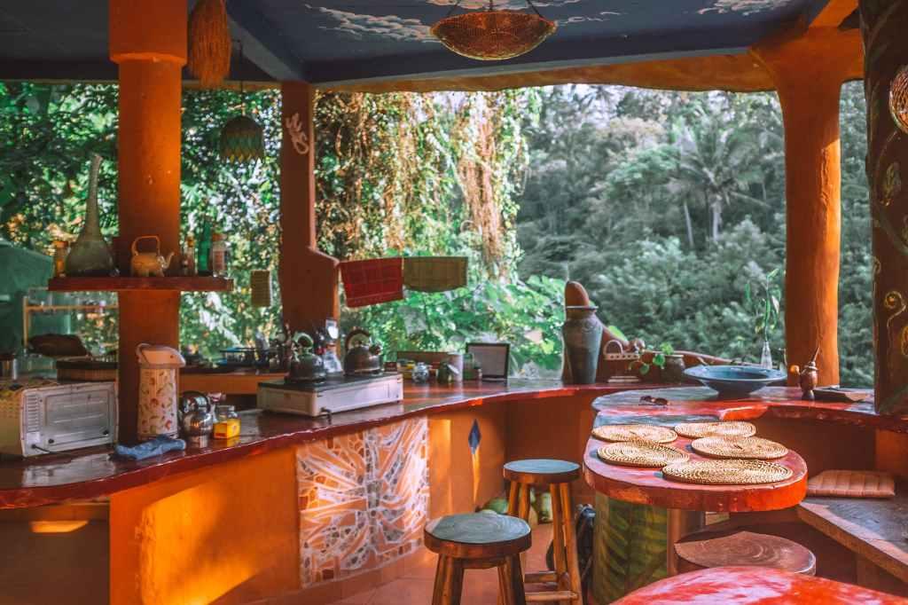 kitchen interior with furniture and utensils against garden