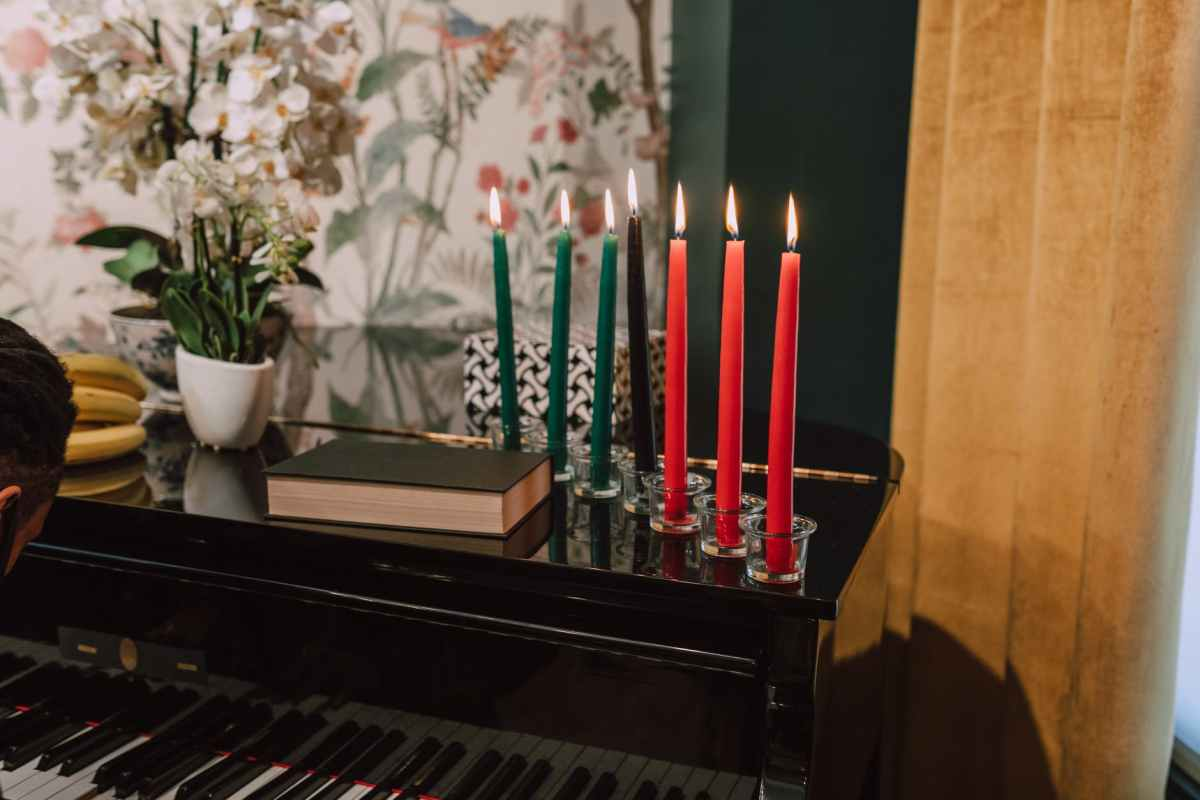 photo of candles on top of piano