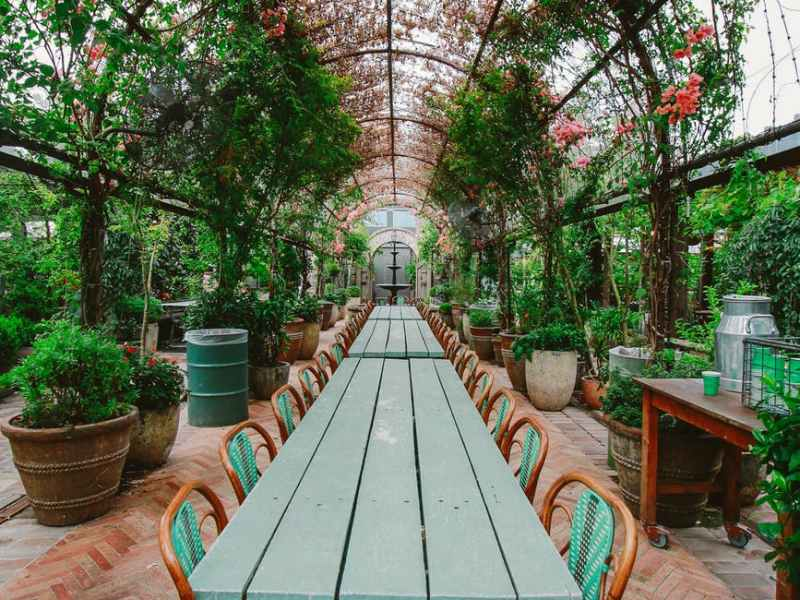 green wooden table with chairs