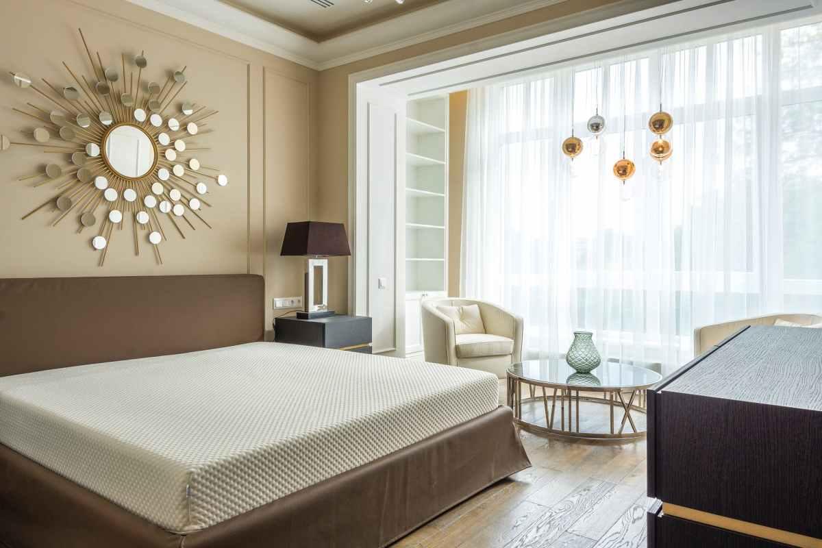 cozy bedroom interior with wide window