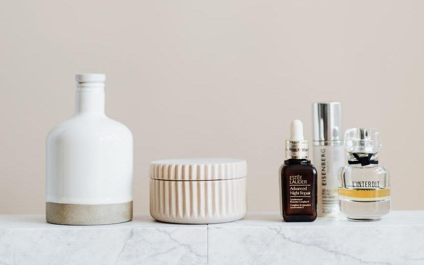 set of cosmetic supply on marble shelf in modern bathroom