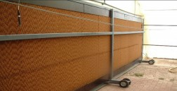 Movable evaporative cooling pads