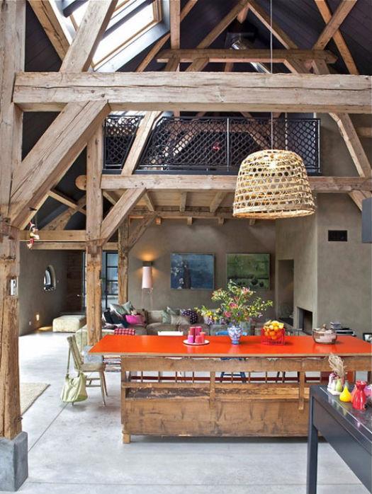 orange tabletop in an open rustic living space