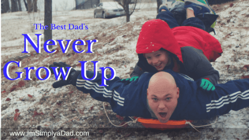 Play with my kids: Image of me and my boy sledding