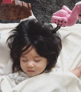 7-month-old baby that has lots of hair like an adult