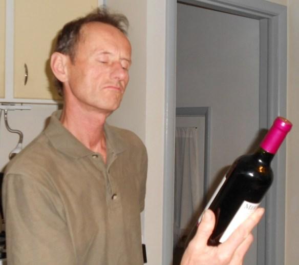 Jim examining wine bottle