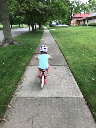 Mia, two months before turning 4, biking around the block with NO training wheels.