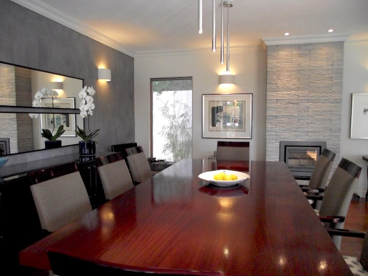 Dining room with feature wall and fireplace