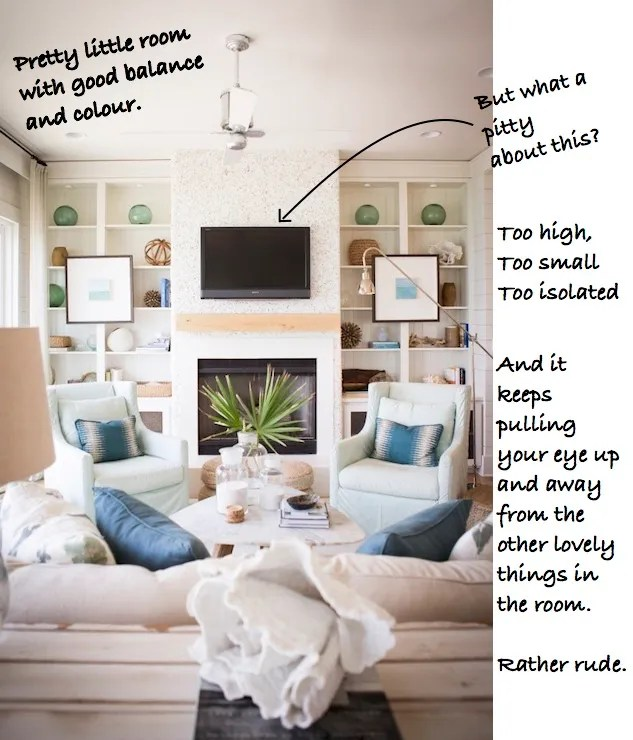 TV in living room with cream sofa