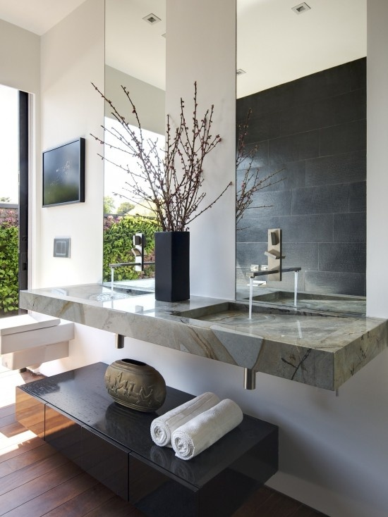 add more space to your bathroom vertical mirrors more light