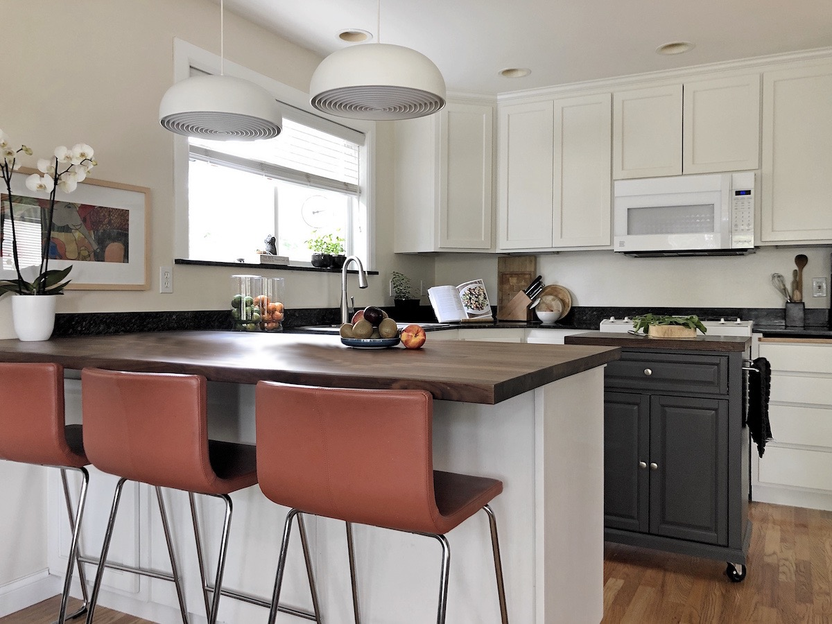 Kitchen upgrade with white painted cupboards and butcher's block counter