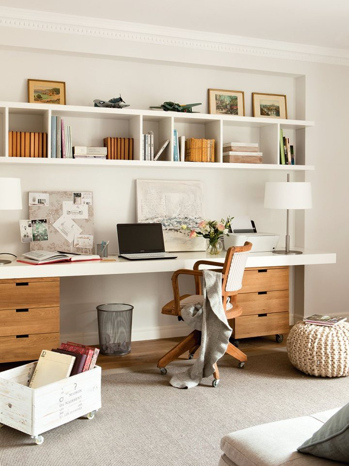 Cozy home office with built-in shelving and neutral colors