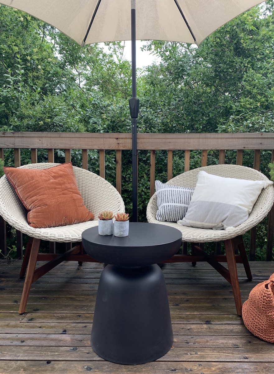 Small Deck with mid-century modern chairs and umbrella