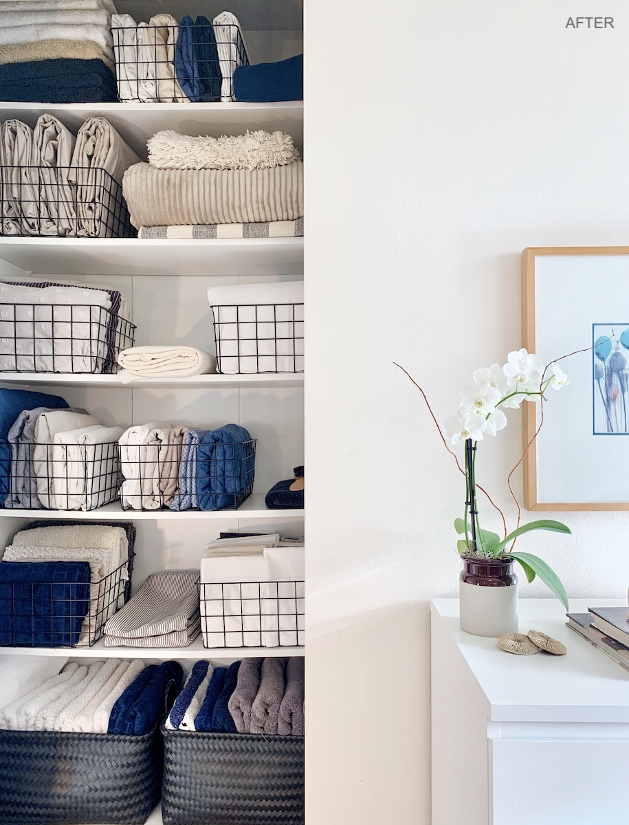 Linen closet after decluttering and professional organizing