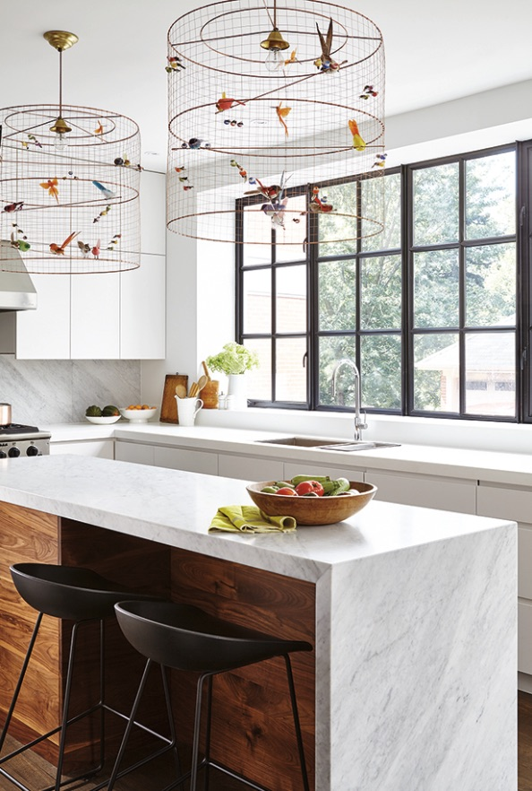 Narrow-kitchen-island-with-flat-front-walnut-cabinets-with-recessed-pulls-and-white-countertop